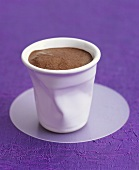 Coffee cream in a dented beaker