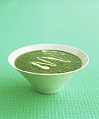 A bowl of parsley soup with saffron cream