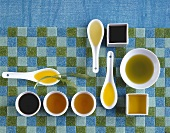 Various types of oil in spoons and dishes