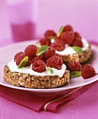 Wholemeal biscuits topped with yoghurt and fresh raspberries