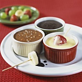 Chocolate fondue made with different chocolates, with fruit