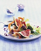 Prawns on winter salad with figs