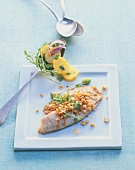 Tilapia with walnut & chervil crust and potato & rocket salad