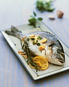 Gilthead seabream with garlic, herbs and lemon