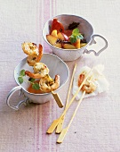 Fried prawn skewers with peach and tomato salad