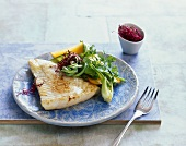 Fried pangasius with vegetable salad and beetroot sprouts