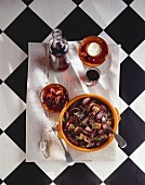 Offal and onion stew with olives and red wine, Portugal