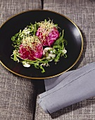 Beetroot and sheep's cheese balls with rocket and sprouts