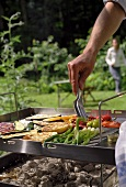 Man barbecuing vegetables