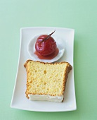 A slice of angel food cake with spiced plum
