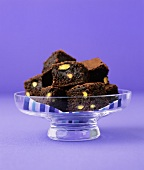 Pistachio brownies in a glass dish