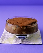 Chocolate tiramisu in a glass dish