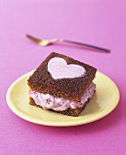 Ginger cake with rhubarb fool filling and sugar heart