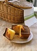 Pound cake, a piece cut, with a picnic basket