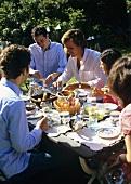 Friends having breakfast in garden