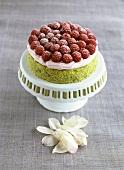 Pistachio cake with rose cream and raspberries