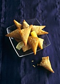 Deep-fried cheese and herb pasties with lime