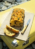 Olive and bacon bread, partly sliced