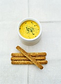 Curry quark dip with sesame sticks