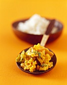 Yellow lentils with mango and exotic spices, rice