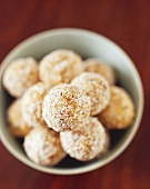 Muesli and mango truffles coated in coconut