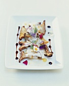 Fried king trumpet mushrooms with a truffle cream sauce and edible flowers