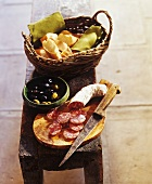Saucisson with olives and baguette