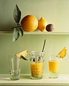 Exotic fruit juice in measuring jug and glass
