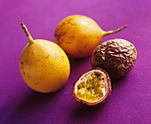 Whole golden passion fruits & whole & half purple passion fruit
