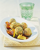 Sesame-coated rice balls with vegetables
