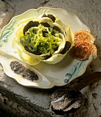 Cabbage salad with black truffle, bacon and tapenade