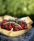 Fresh berries and rosemary in wafer bowl