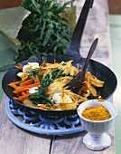 Pan-fried carrots & potatoes with rocket, feta & curry powder