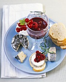 Different goats' cheeses with berry confit and baguette