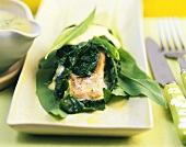 Spinach-wrapped salmon with ramsons (wild garlic)