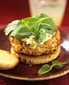 Salmon burger with lime mayonnaise and spinach leaves
