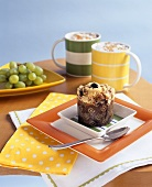 Blueberry muffin with two cups of cappuccino