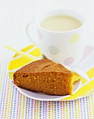 A piece of carrot cake with tea