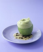 Avocado mousse in an avocado with coriander dressing
