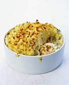 Smoked haddock pie with prawns and mashed potato and parsnip