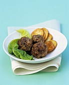 Lamb balls with fried potatoes and cabbage