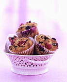 Muffins with dried fruit and raspberries