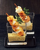 Fried fish kebabs with mustard sauce in glasses