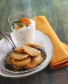 Blinis with yoghurt sauce and trout caviar