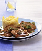 Pork with garlic and olive sauce and mashed potato