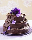 Three-tiered chocolate cake with flowers