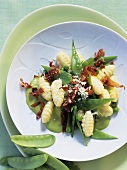 Gnocchi with peas, mangetout and bacon