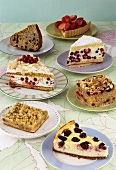 Seven different pieces of cake made with berries