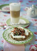 Cream cheese and vegetables on wholemeal bread, latte macchiato