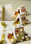 Gingerbread houses made with biscuits and decorated with jelly sweets